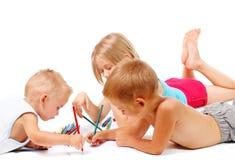 Grupo de desenhar das crianças fotos de stock royalty free