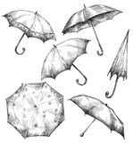 Grupo de desenhos do guarda-chuva, desenhado à mão ilustração stock