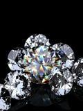 Grupo de diamantes en fondo negro Imágenes de archivo libres de regalías