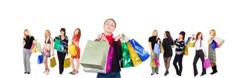 Grupo de diez muchachas de compras Imágenes de archivo libres de regalías