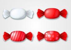 Grupo de doces coloridos nos envoltórios - vermelho e branco Fotos de Stock