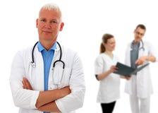 Grupo de doctores con el doctor europeo Fotografía de archivo libre de regalías