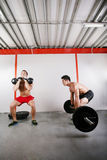 Grupo de ejercicio de dos personas Foto de archivo libre de regalías