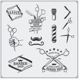Grupo de elementos, de etiquetas, de crachás e de emblemas do projeto da barbearia do vintage Foto de Stock Royalty Free