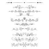 Grupo de elementos decorativos dos redemoinhos, divisores, decorações da página Fotografia de Stock
