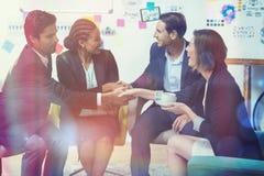 Grupo de empresários que agitam as mãos Foto de Stock Royalty Free
