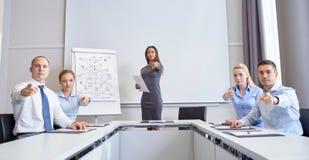 Grupo de empresarios que señalan el finger en usted Imagen de archivo libre de regalías