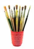 Grupo de escovas da pintura no copo vermelho Imagem de Stock Royalty Free