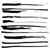 Grupo de escovas de tinta preta ilustração stock