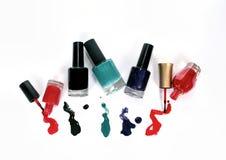 Grupo de esmalte de uñas en el fondo blanco Foto de archivo libre de regalías