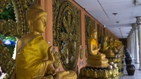 Grupo de estátuas da Buda no templo, Banguecoque Tailândia Imagem de Stock