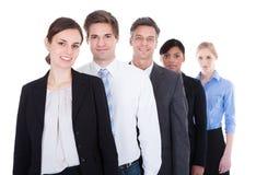 Grupo de estar dos empresários Imagens de Stock Royalty Free