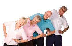 Grupo de estirar maduro de la gente Foto de archivo libre de regalías