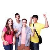 Grupo de estudantes entusiasmado imagem de stock