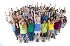 Grupo de estudantes que aumentam seus braços Fotografia de Stock