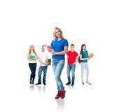Grupo de estudiantes adolescentes aislados en blanco Imagen de archivo
