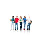 Grupo de estudiantes adolescentes aislados en blanco Imagenes de archivo