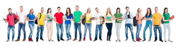 Grupo de estudiantes adolescentes aislados en blanco Imagen de archivo libre de regalías