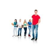Grupo de estudiantes adolescentes aislados en blanco Foto de archivo