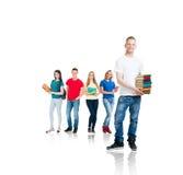 Grupo de estudiantes adolescentes aislados en blanco Imágenes de archivo libres de regalías