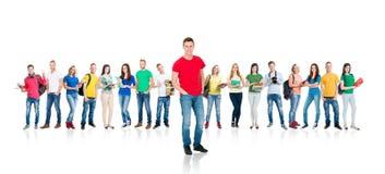 Grupo de estudiantes adolescentes aislados en blanco Fotografía de archivo libre de regalías