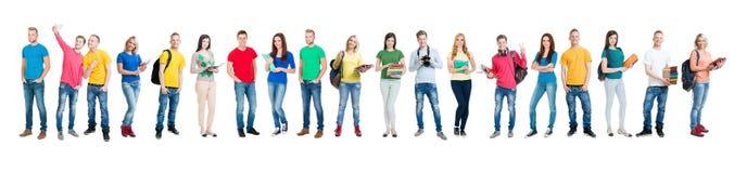 Grupo de estudiantes adolescentes aislados en blanco Foto de archivo libre de regalías