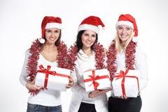 Grupo de estudiantes en el traje de Santa Claus con Christm Imagenes de archivo