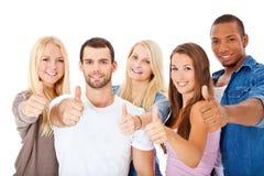 Grupo de estudiantes que muestran los pulgares para arriba Imagen de archivo
