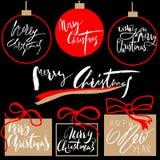 Grupo de etiquetas caligráfico do Feliz Natal do vintage e do ano novo feliz e tipográfico Handdrawn Elementos das decorações Foto de Stock