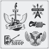 Grupo de etiquetas da loja da guitarra, de emblemas, de crachás e de ícones da música Imagens de Stock Royalty Free