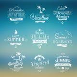 Grupo de etiquetas da praia no fundo azul Imagem de Stock