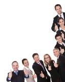 Grupo de executivos dando os polegares acima Fotografia de Stock