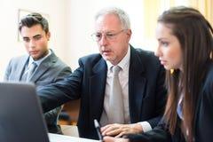 Grupo de executivos no trabalho Imagens de Stock