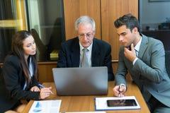 Grupo de executivos no trabalho Fotos de Stock Royalty Free