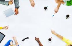 Grupo de executivos que planeiam para um projeto novo Imagens de Stock Royalty Free