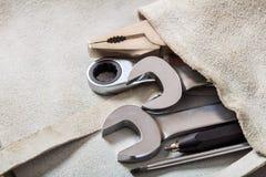 Grupo de ferramentas da mão em um bolso Imagens de Stock