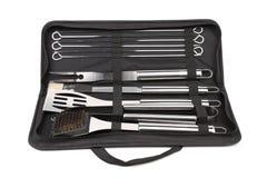 Grupo de ferramentas para o BBQ no saco preto. Imagens de Stock Royalty Free