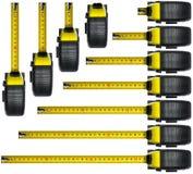 Grupo de fitas métricas no fundo branco Imagens de Stock