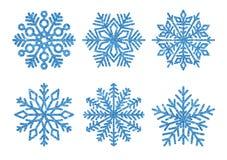 Grupo de flocos de neve dourados do brilho Flocos de neve de brilho no fundo branco Imagens de Stock Royalty Free