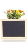 Grupo de flores com quadro-negro imagens de stock
