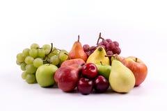 Grupo de frutas meridionales en un fondo blanco Foto de archivo