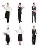 Grupo de garçom e de empregada de mesa fotos de stock