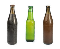 Grupo de garrafas de cerveja isoladas Fotografia de Stock Royalty Free