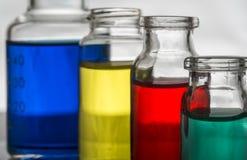 Grupo de garrafas do laboratório com líquido Foto de Stock Royalty Free