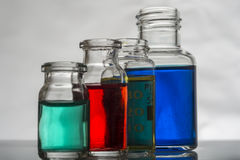 Grupo de garrafas do laboratório com líquido Fotos de Stock Royalty Free