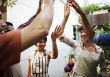 Grupo de gente diversa con las manos aumentadas imágenes de archivo libres de regalías