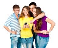 Grupo de gente joven con el teléfono Imagen de archivo libre de regalías