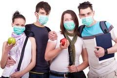 Grupo de gente joven con la máscara Imagen de archivo