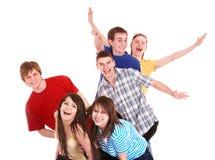 Grupo de gente joven feliz con la mano para arriba. Foto de archivo libre de regalías
