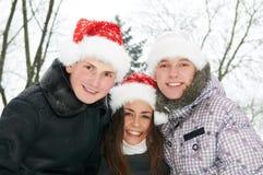 Grupo de gente joven feliz en invierno Fotos de archivo libres de regalías
